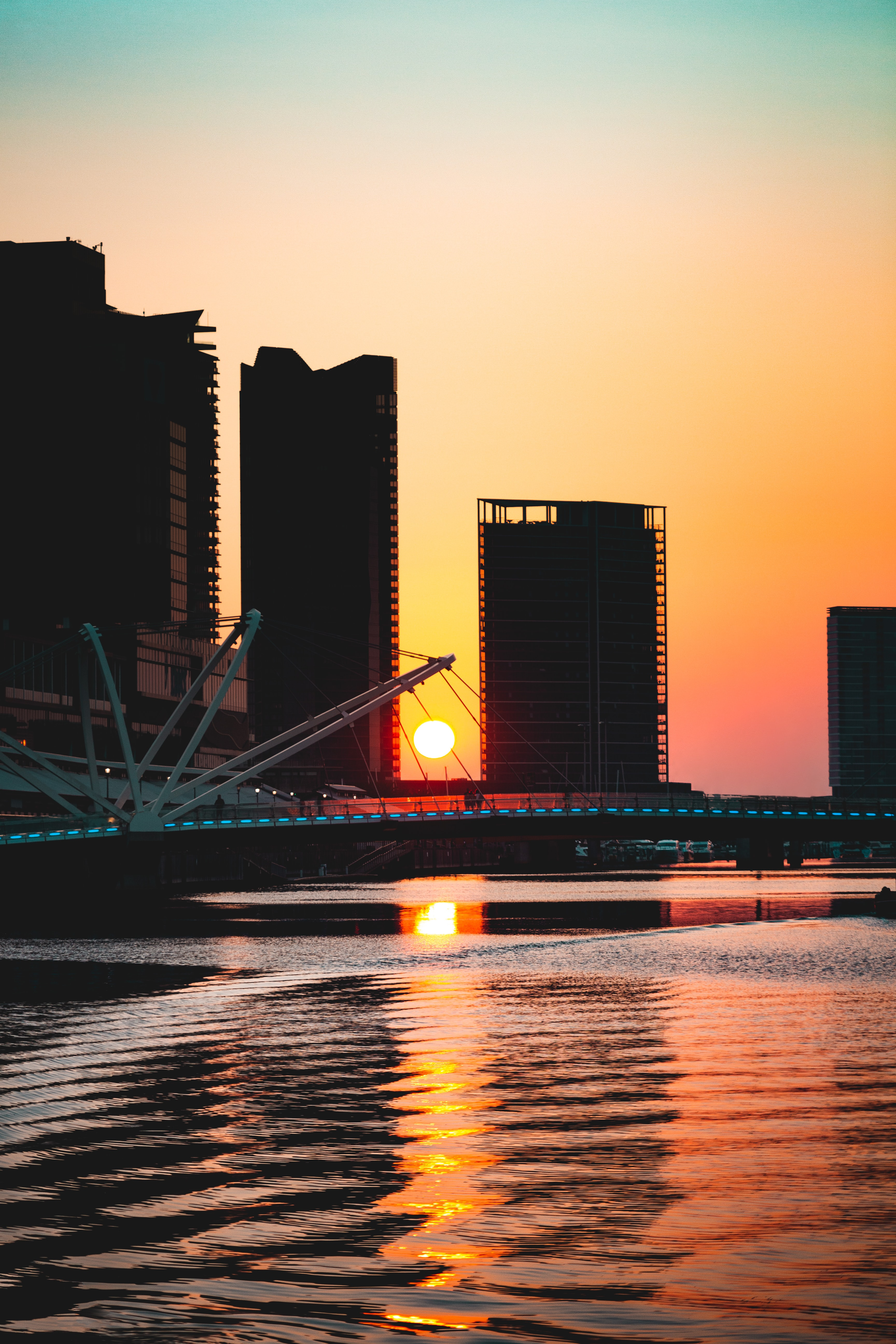 land bridge and buildings during sunset