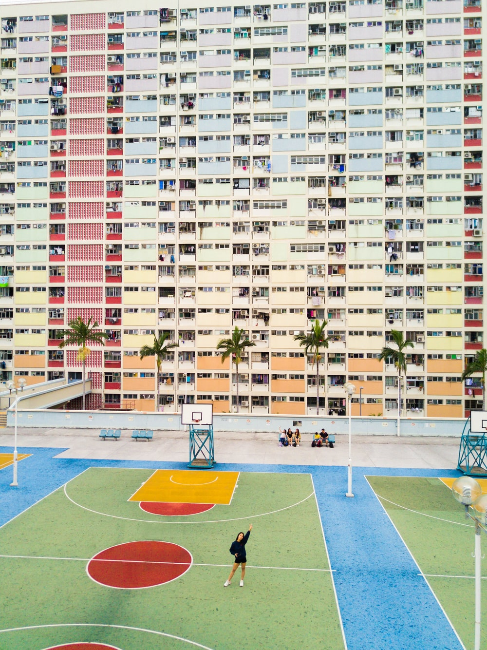 woman standing on basketball court near hote