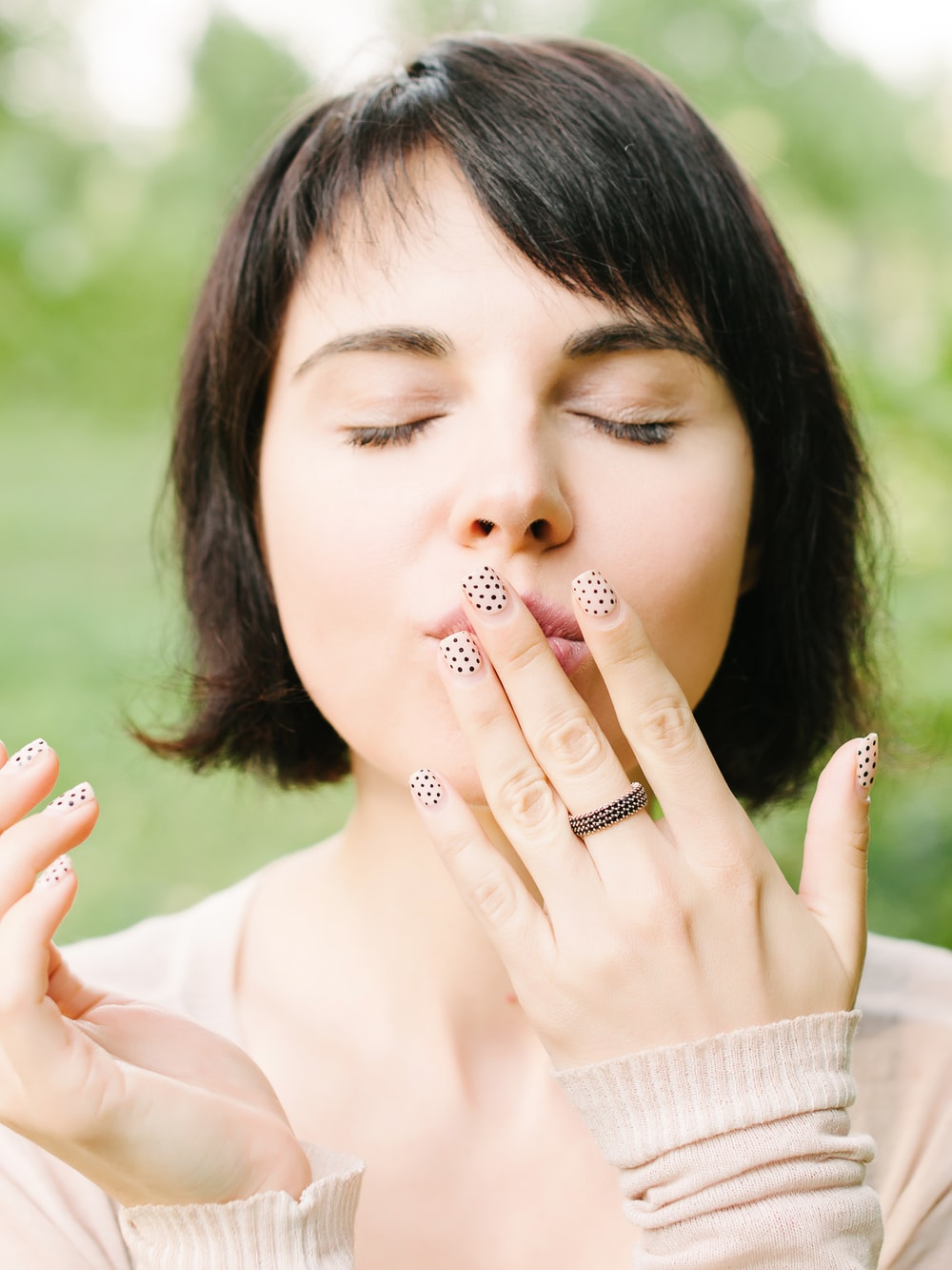 woman touching lips with left hand
