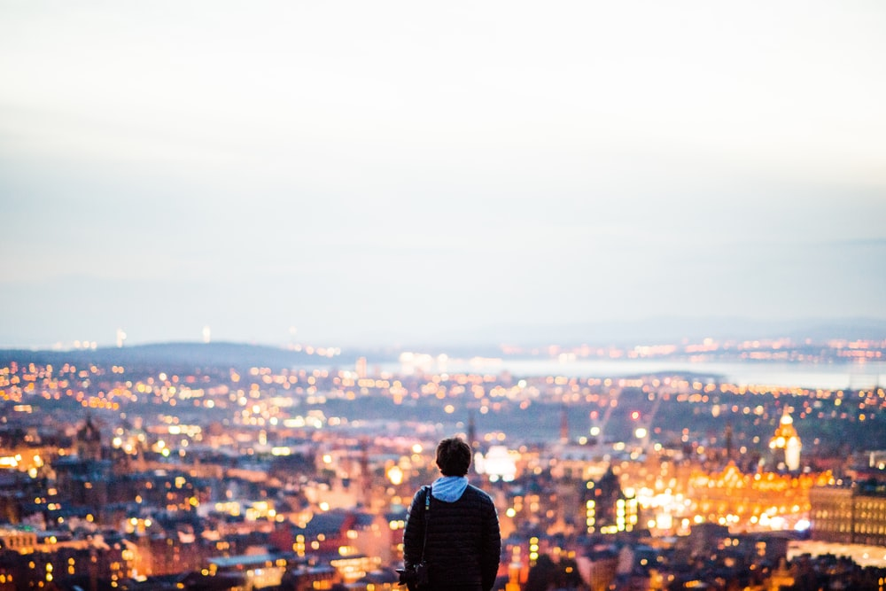 man standing in city scape view