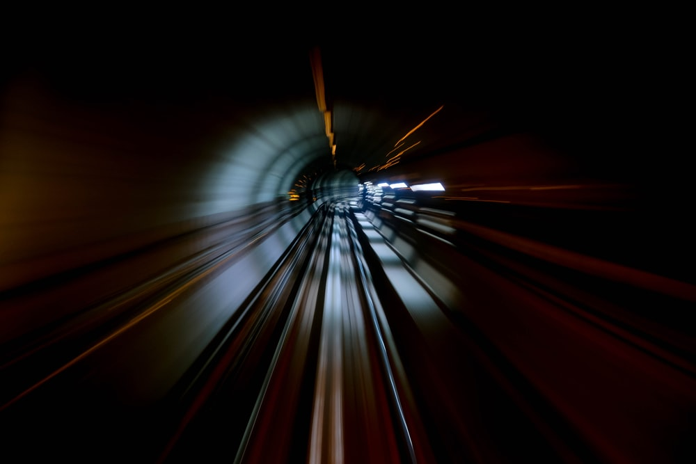 time-lapse photography of tunnel