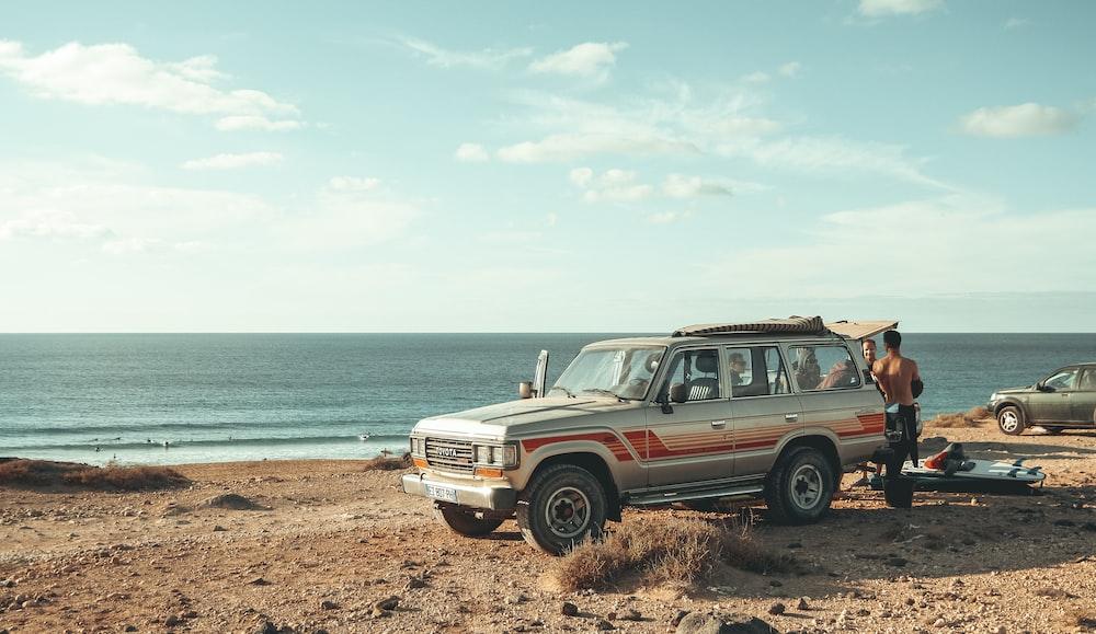 silver SUV near beach