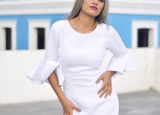 woman standing near blue building