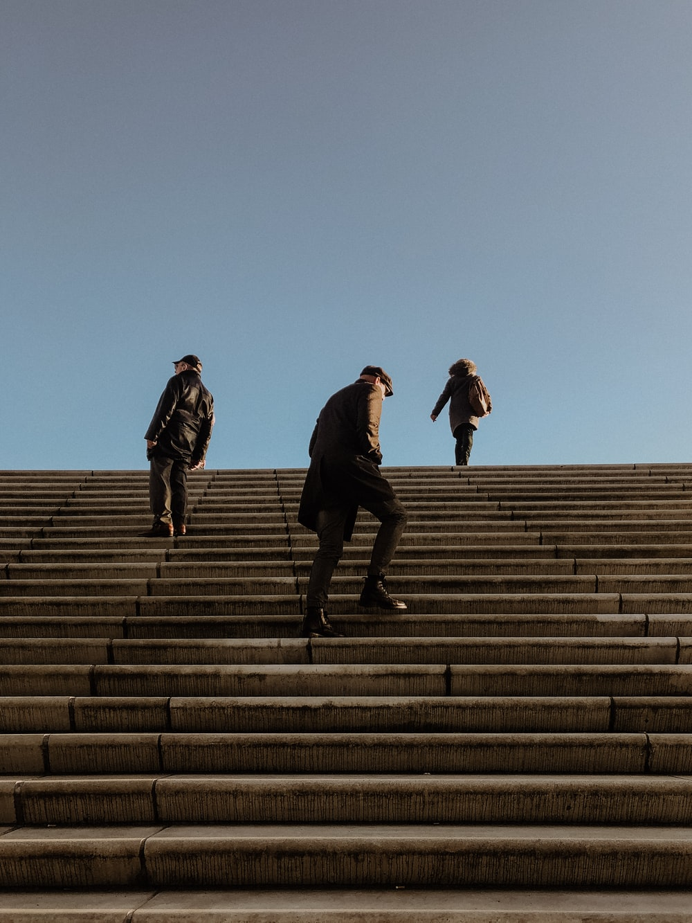low angle photo of people walking on stairways