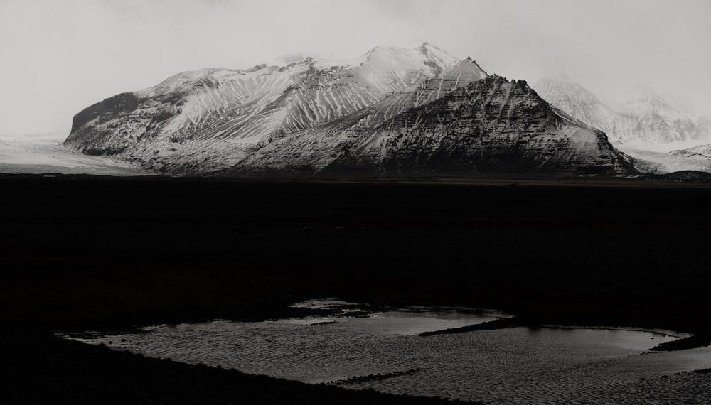 grayscale photography of snow-capped mountain
