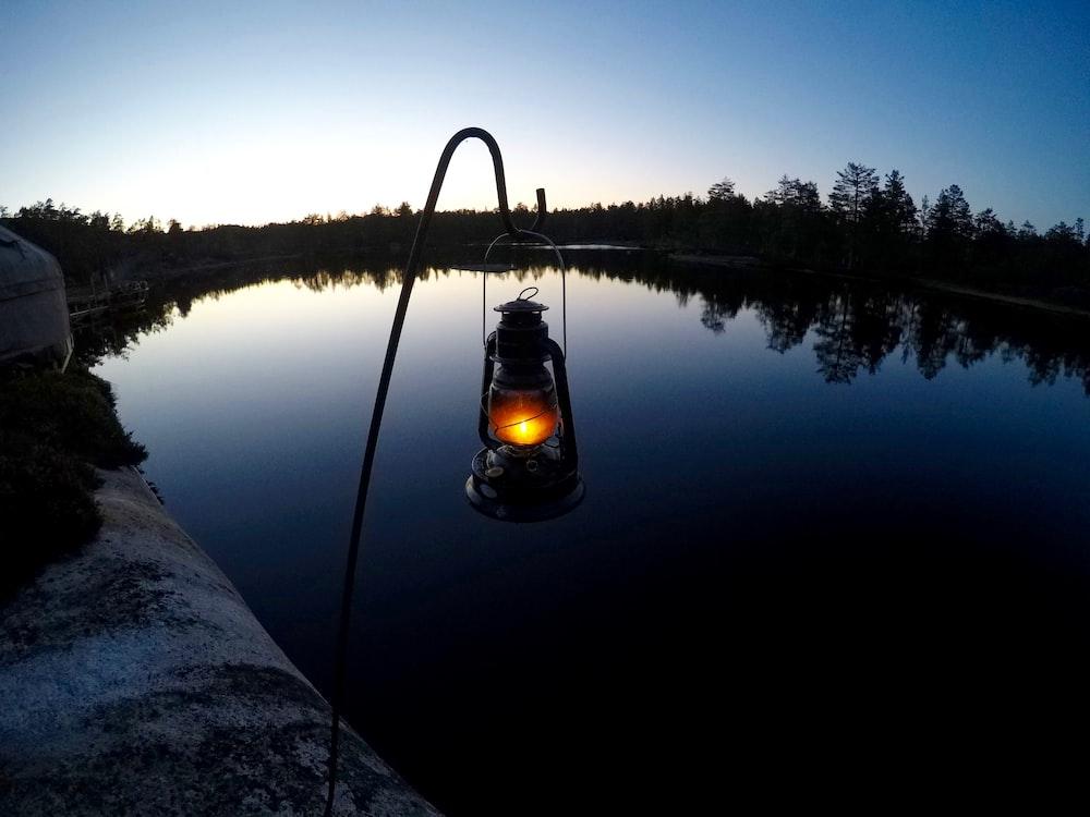 lamp near body of water