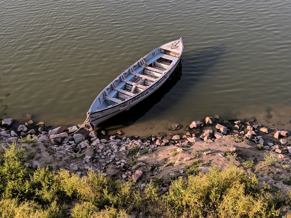brown and white canoe boat
