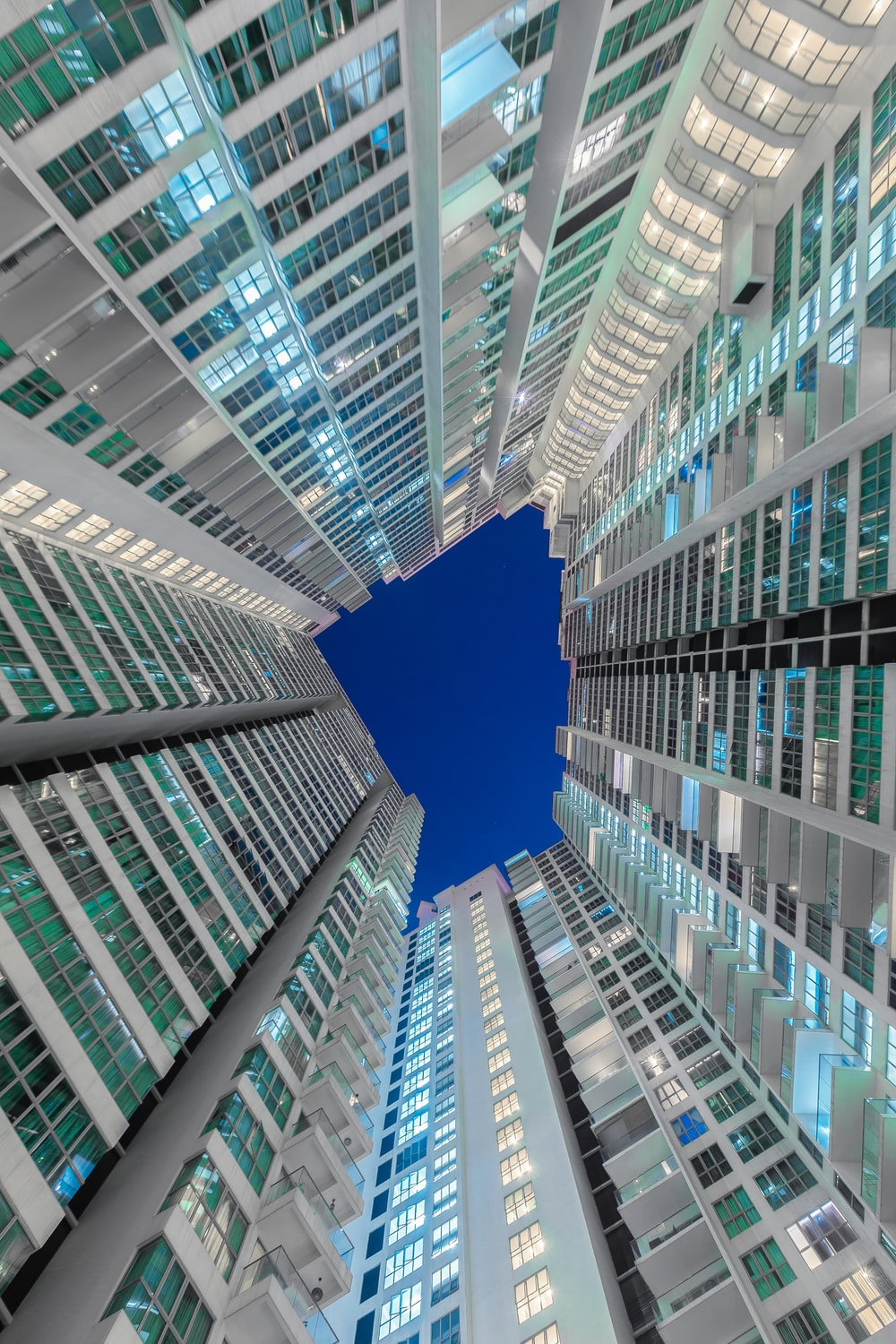 low angle photography of glass curtain buildings