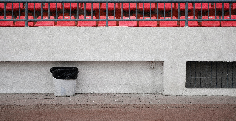 trash bin beside wall