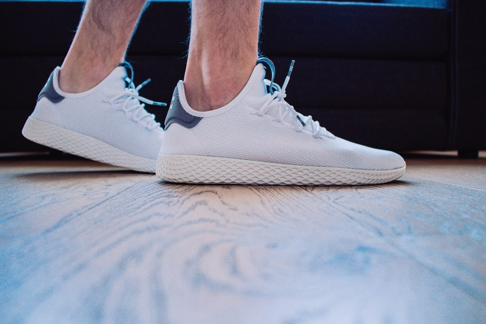 pair of white running shoes