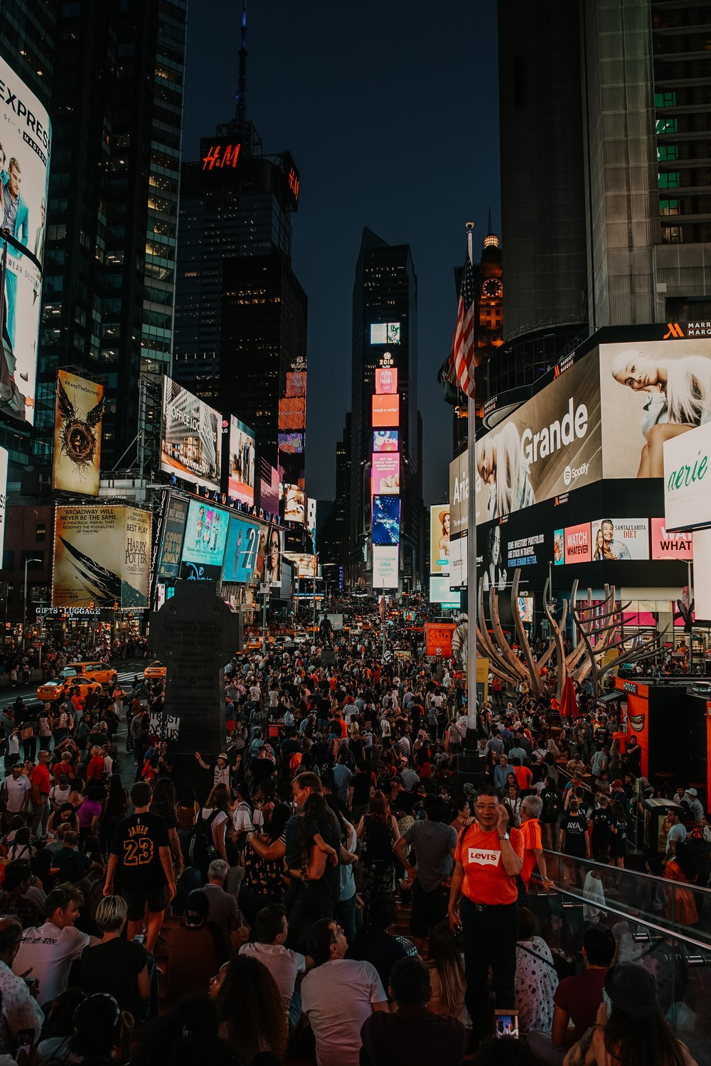 huge crowd of people at New York Times Square at night
