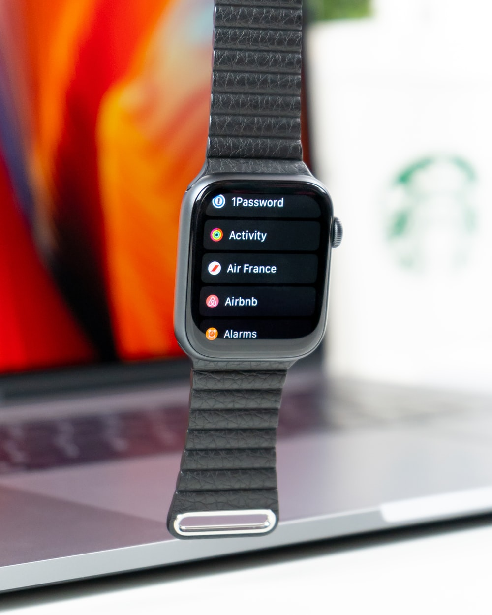silver-colored smartwatch with band