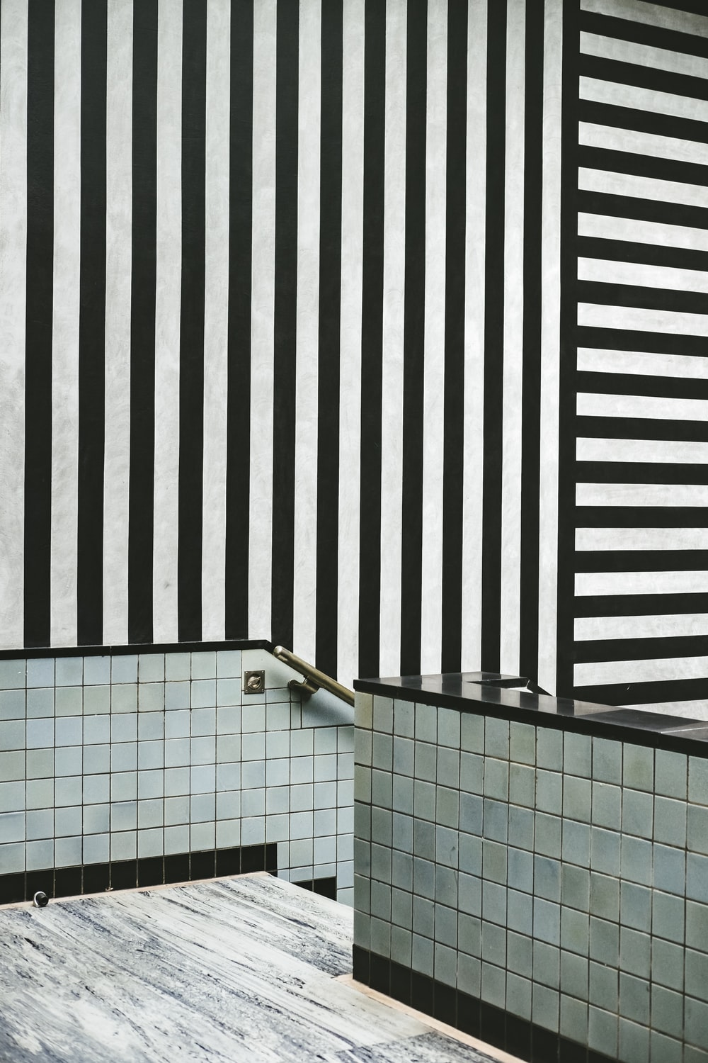 white and black tile stairs ahead