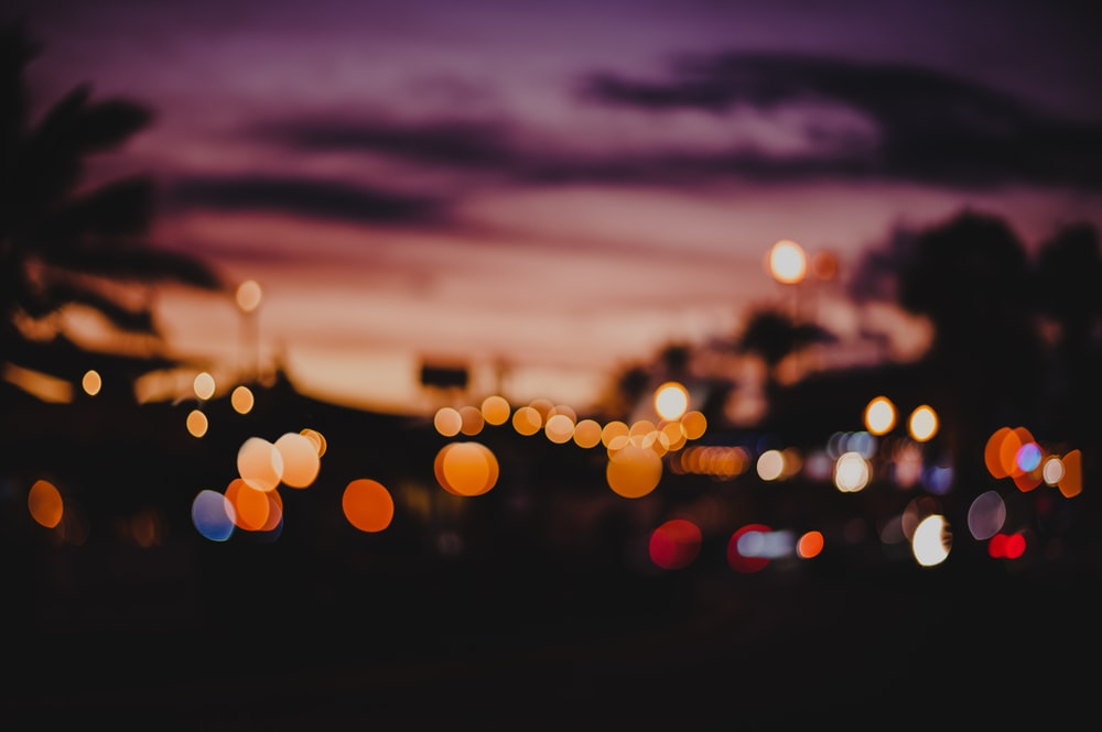 bokeh photography of different colored lights during golden hour