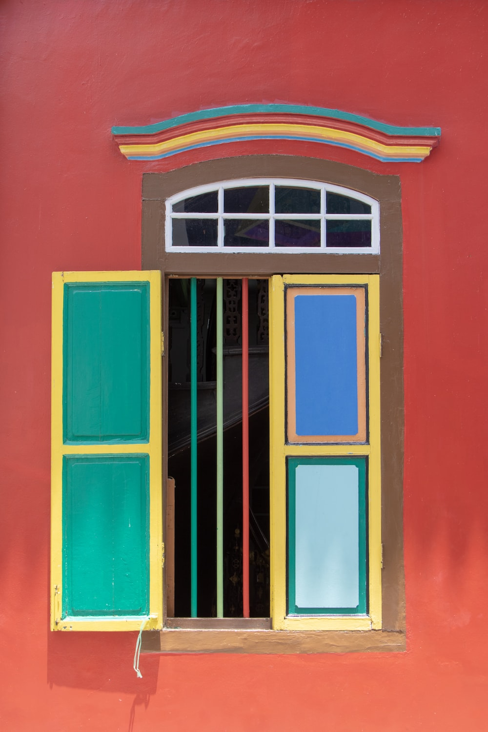 colorful window on red wall
