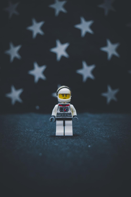 Lego astronaut on gray surface