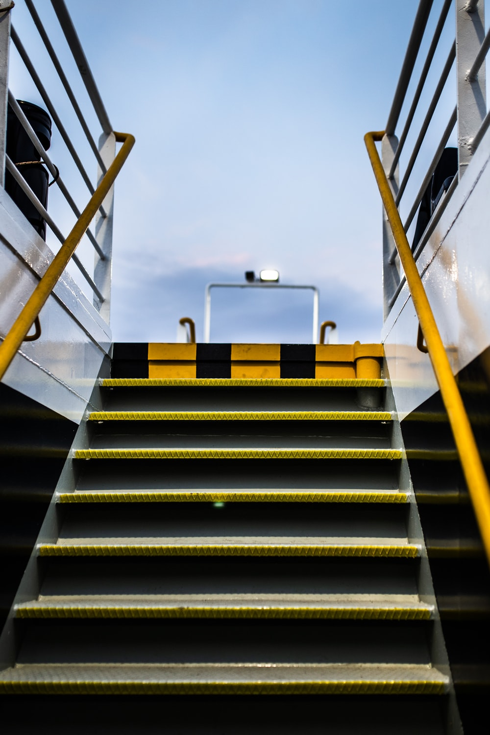 yellow and gray metal stairs