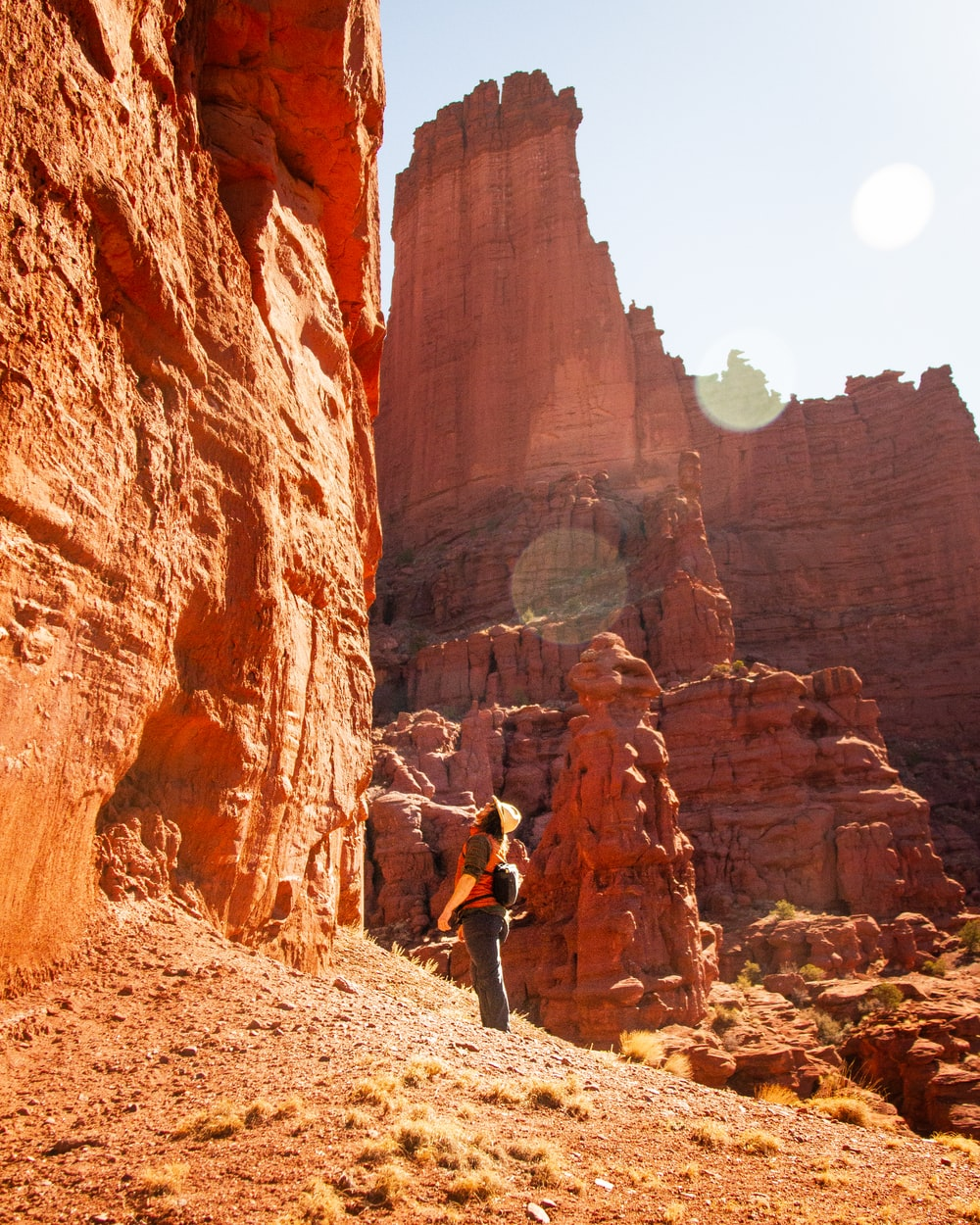 person standing near rock formation