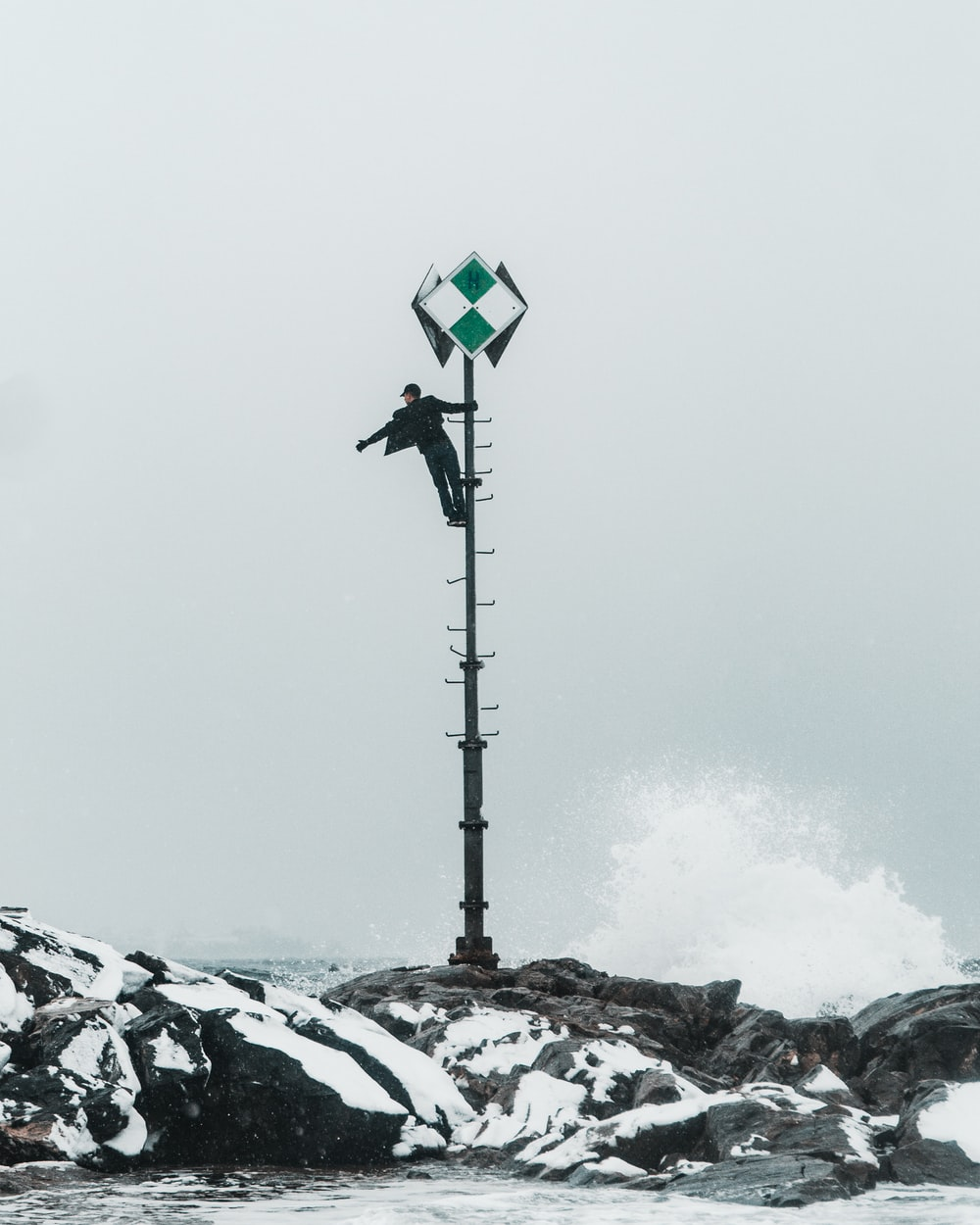 man climbing on pole