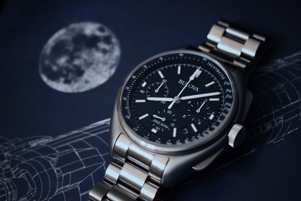 close-up of silver-colored and black chronograph watch
