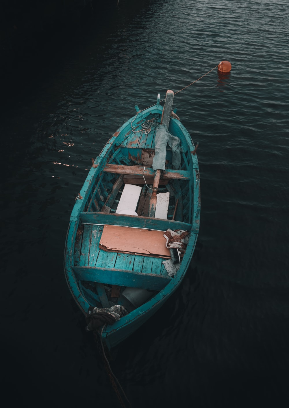 teal wooden boat