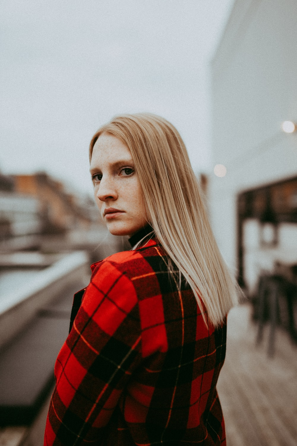 woman wearing black and red plaid jacket