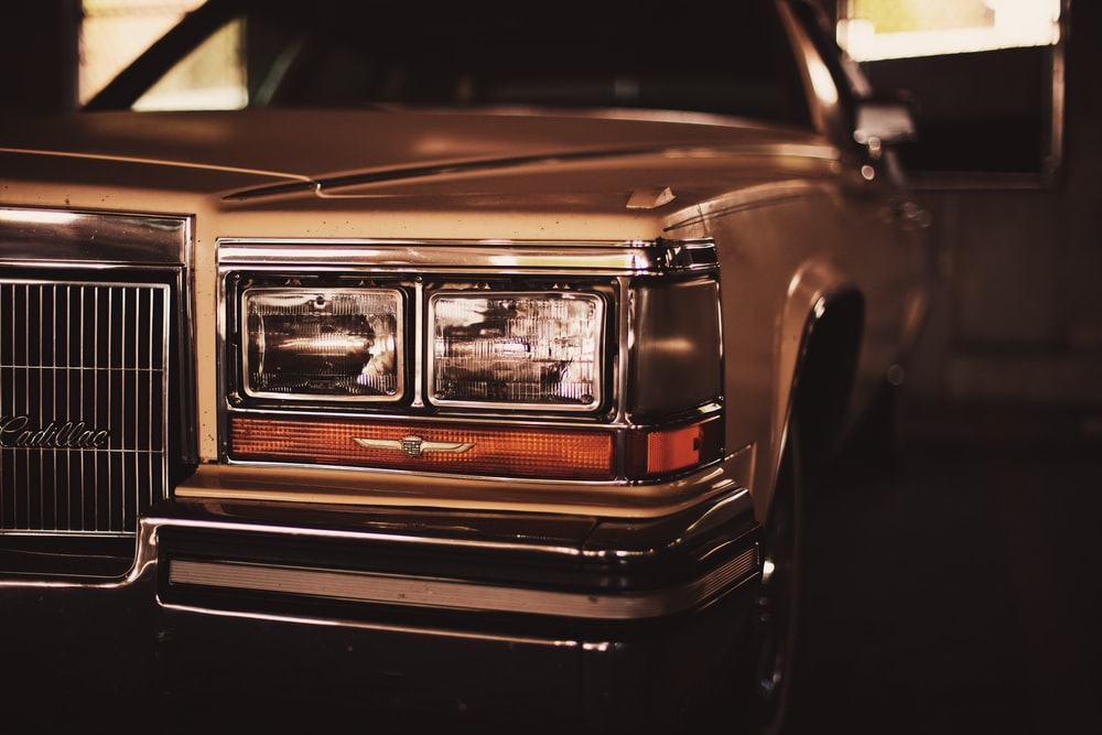 selective focus photo of white Cadillac car