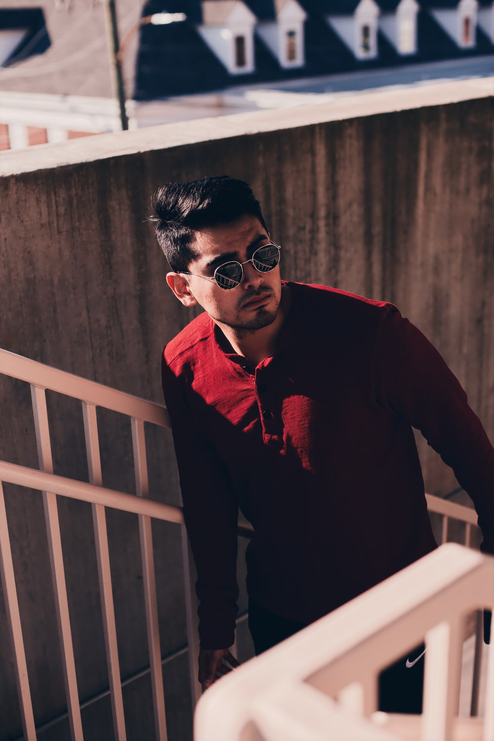 man in red beside stairs