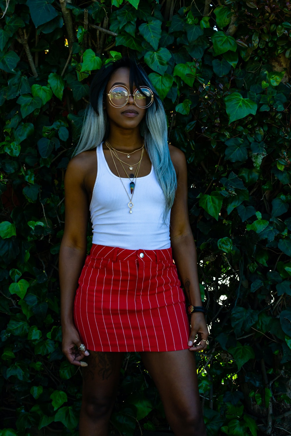 women's white tank top and red skirt