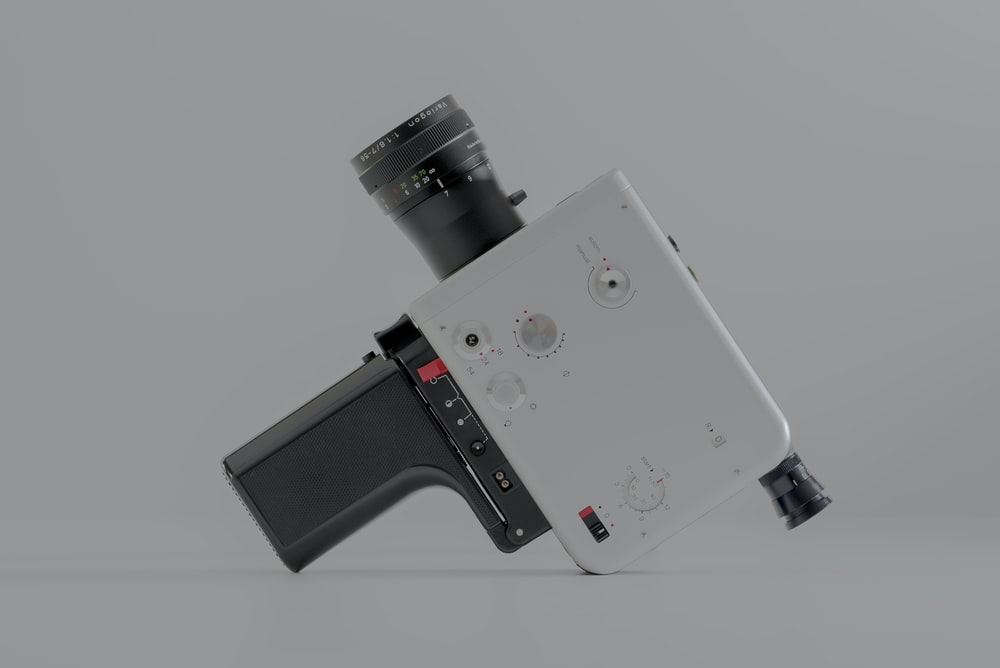 white and black video camera on white surface