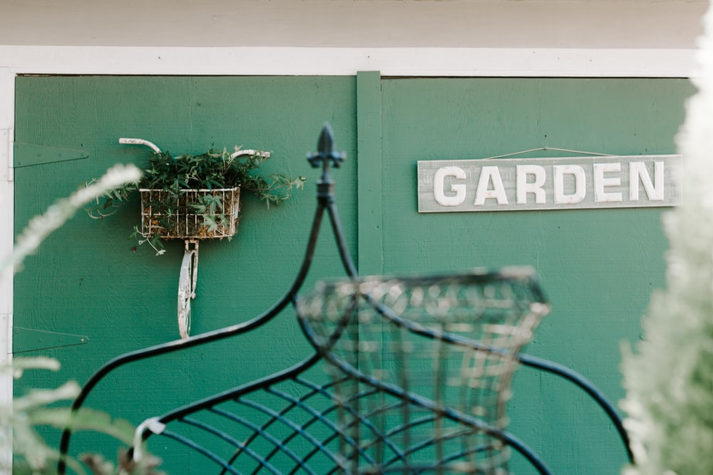 gray and white wooden garden signboard