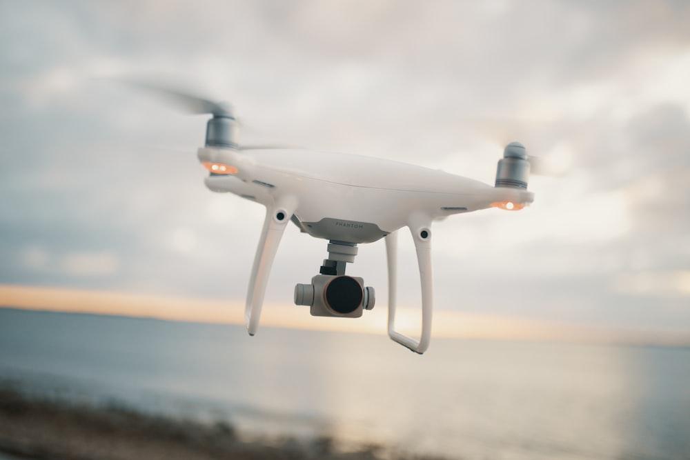 white and gray DJI Standard drone