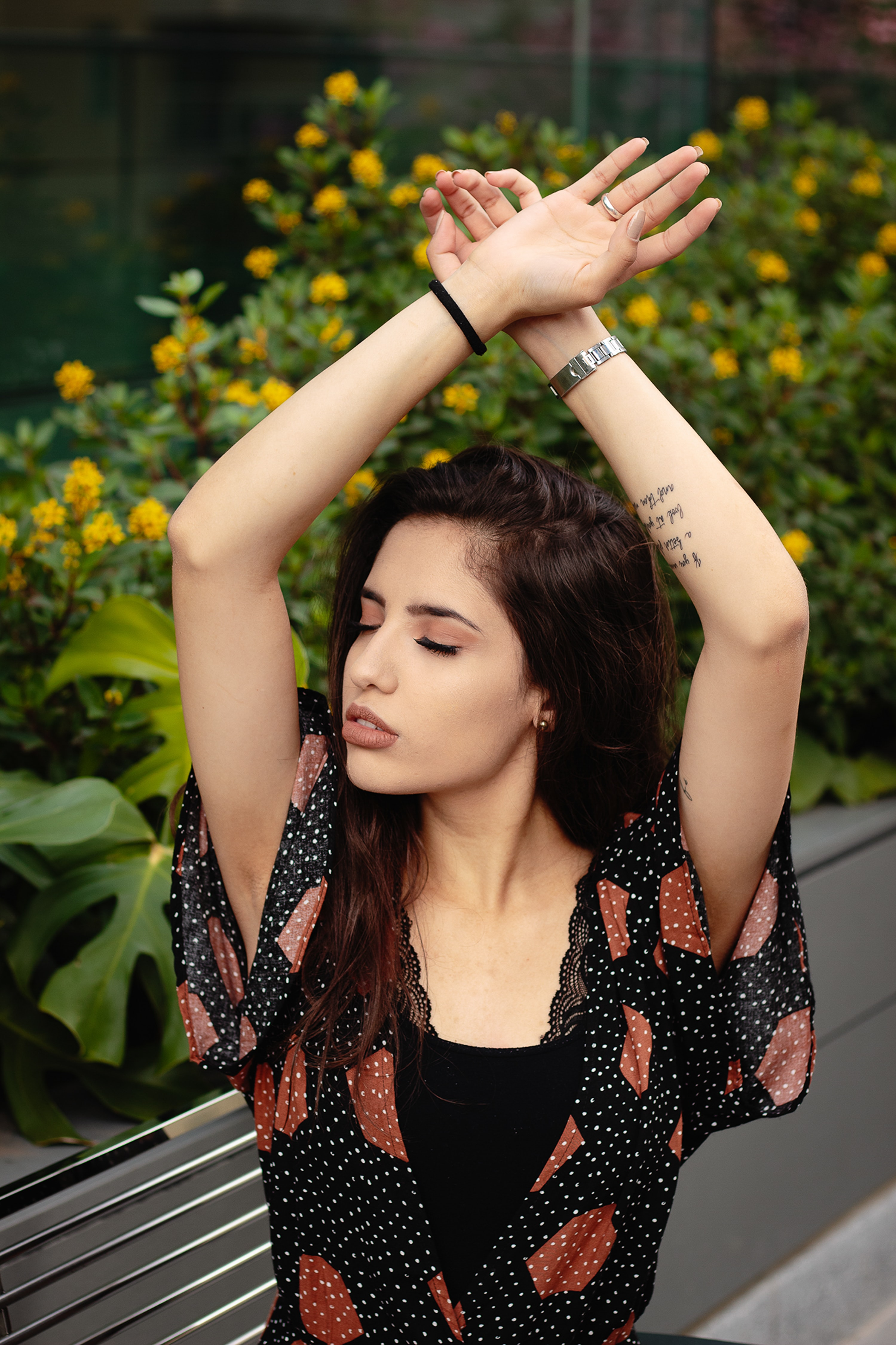 selective focus photo of woman raising her hands
