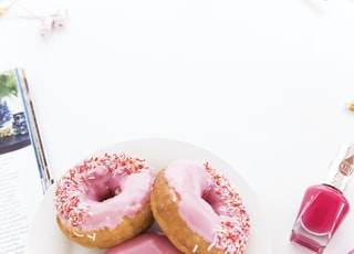 pink glazed donuts on a plate