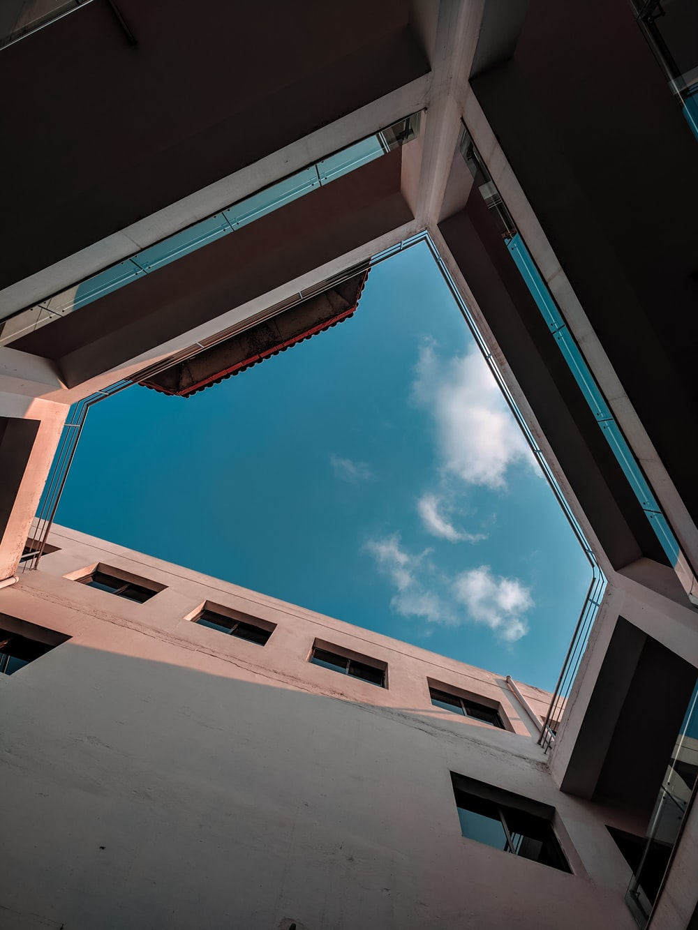 bottom view of concrete building during daytime