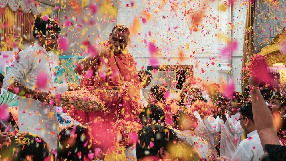 people throwing colorful poweders