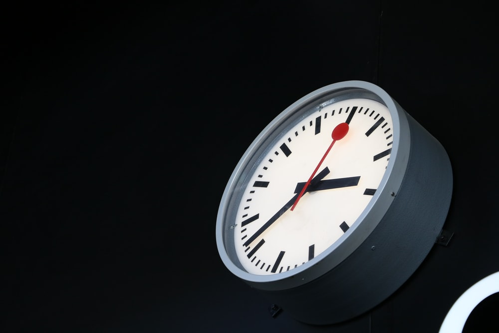 gray and white analog wall clock