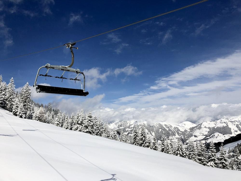 ski lifter during daytime