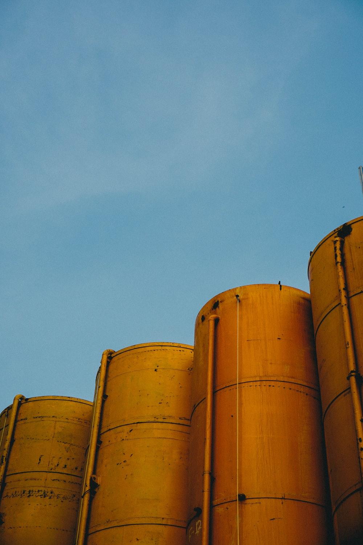 four yellow silos