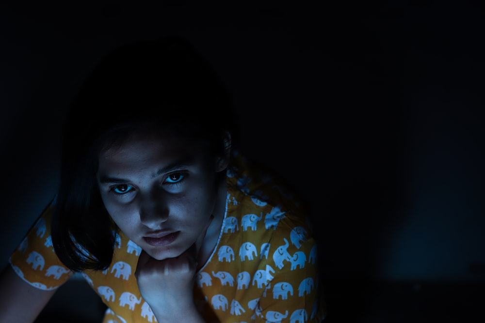 woman looking up inside dim-lit room