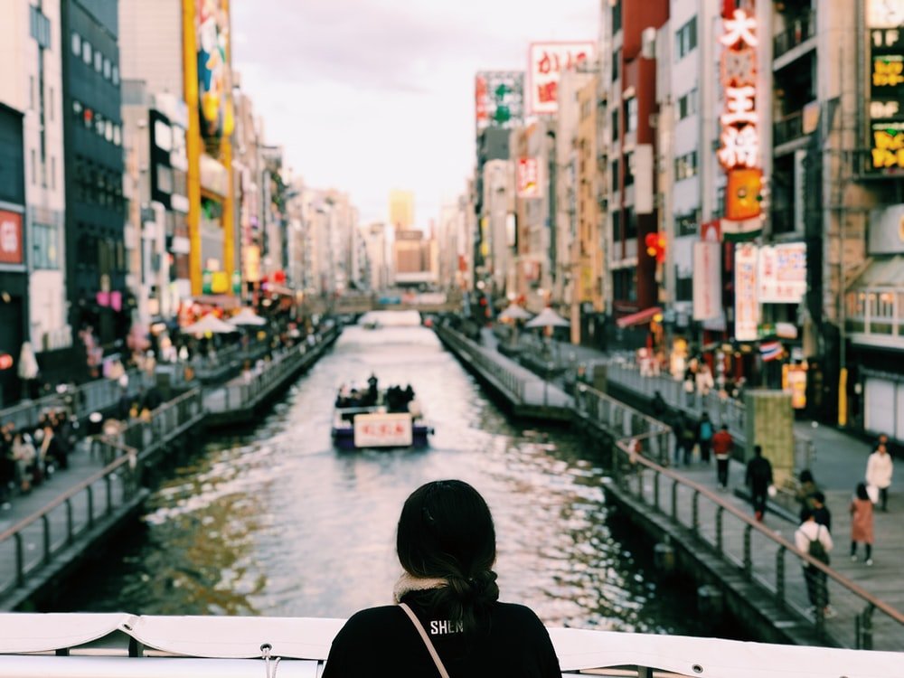 person wearing black top watching river during daytime