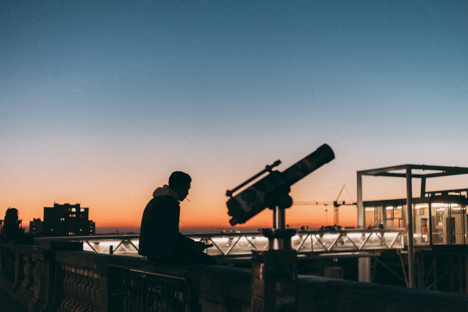 man with a refracting telescope
