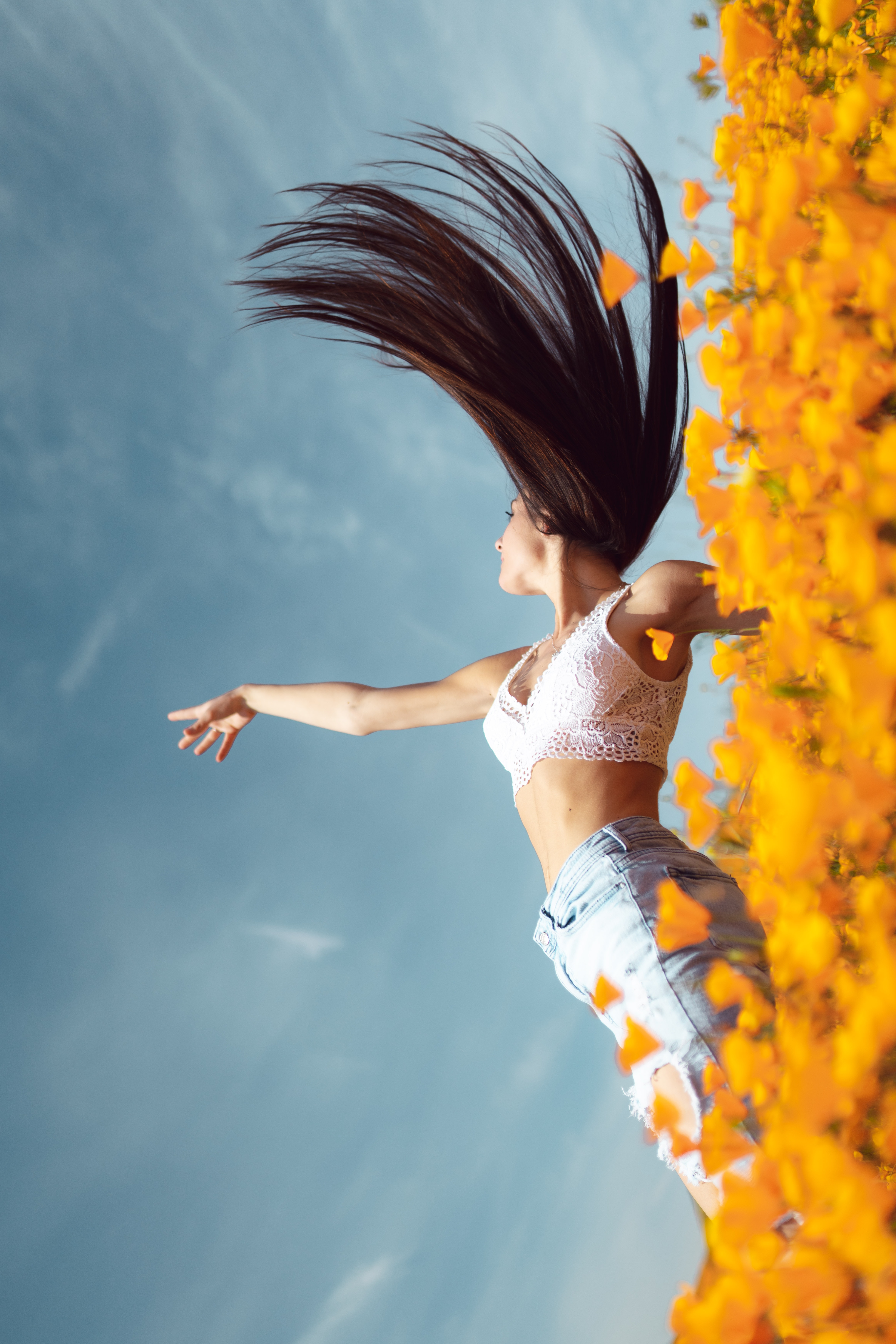 woman about to land on bed of yellow flower