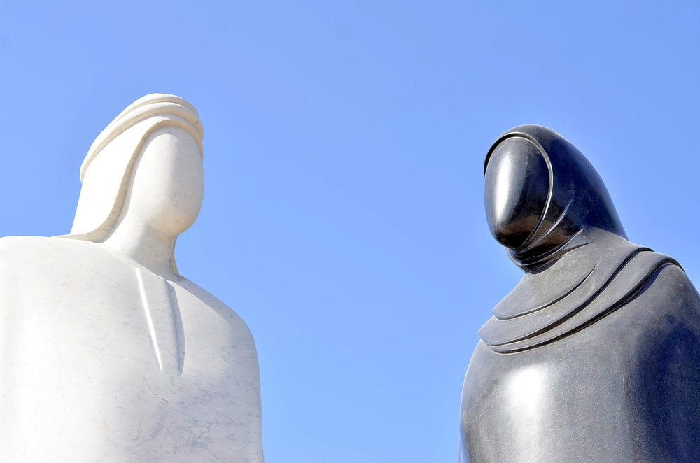 white and black statues
