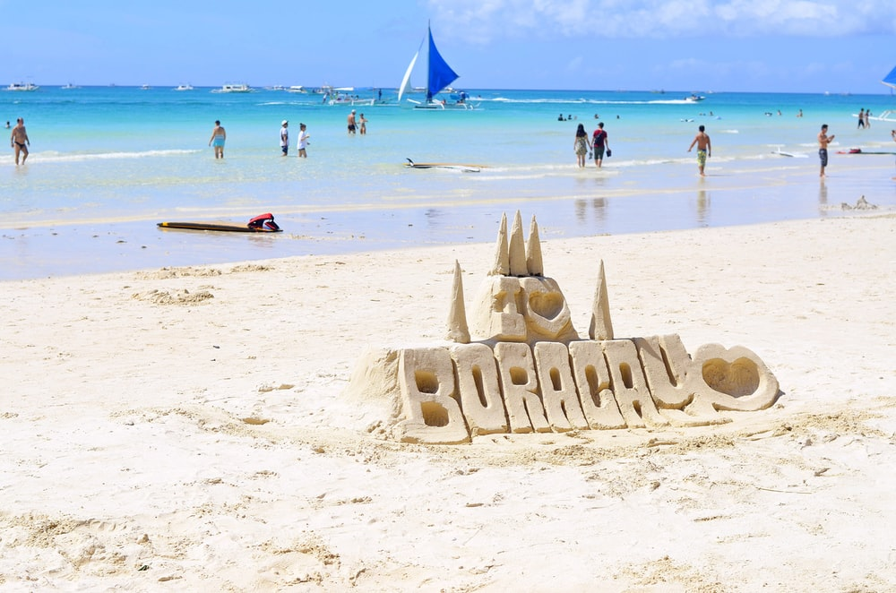 people walking on Boracay beach