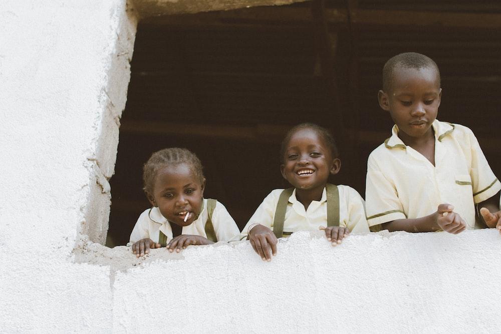 three kids on window