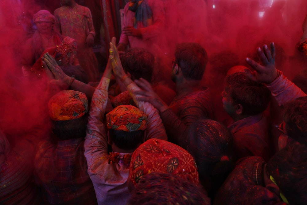man covered in red powder