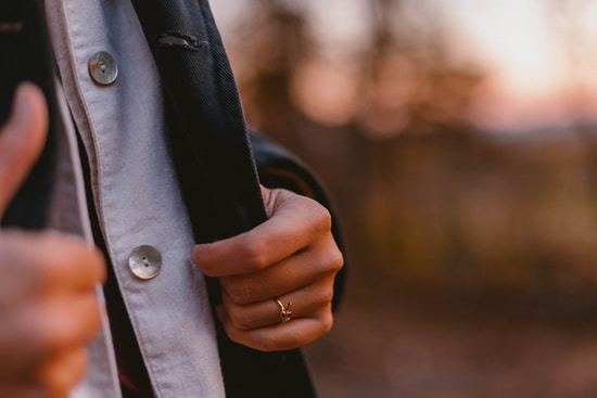 person touching blazer