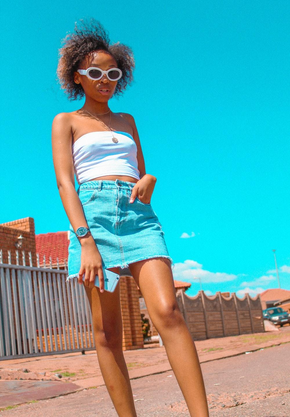 woman wearing white frame sunglasses