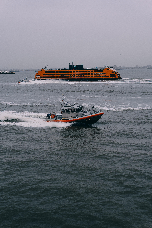 orange and black cruiser ship on body of water